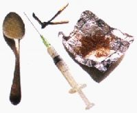 Heroin Tinfoil and Heroin Spoon and Syringe